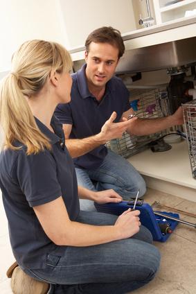 man teaching woman how to do plumbing