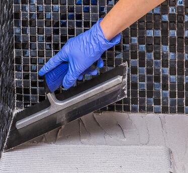 Installing bathroom tile is made easy when you've got the right tools on hand.