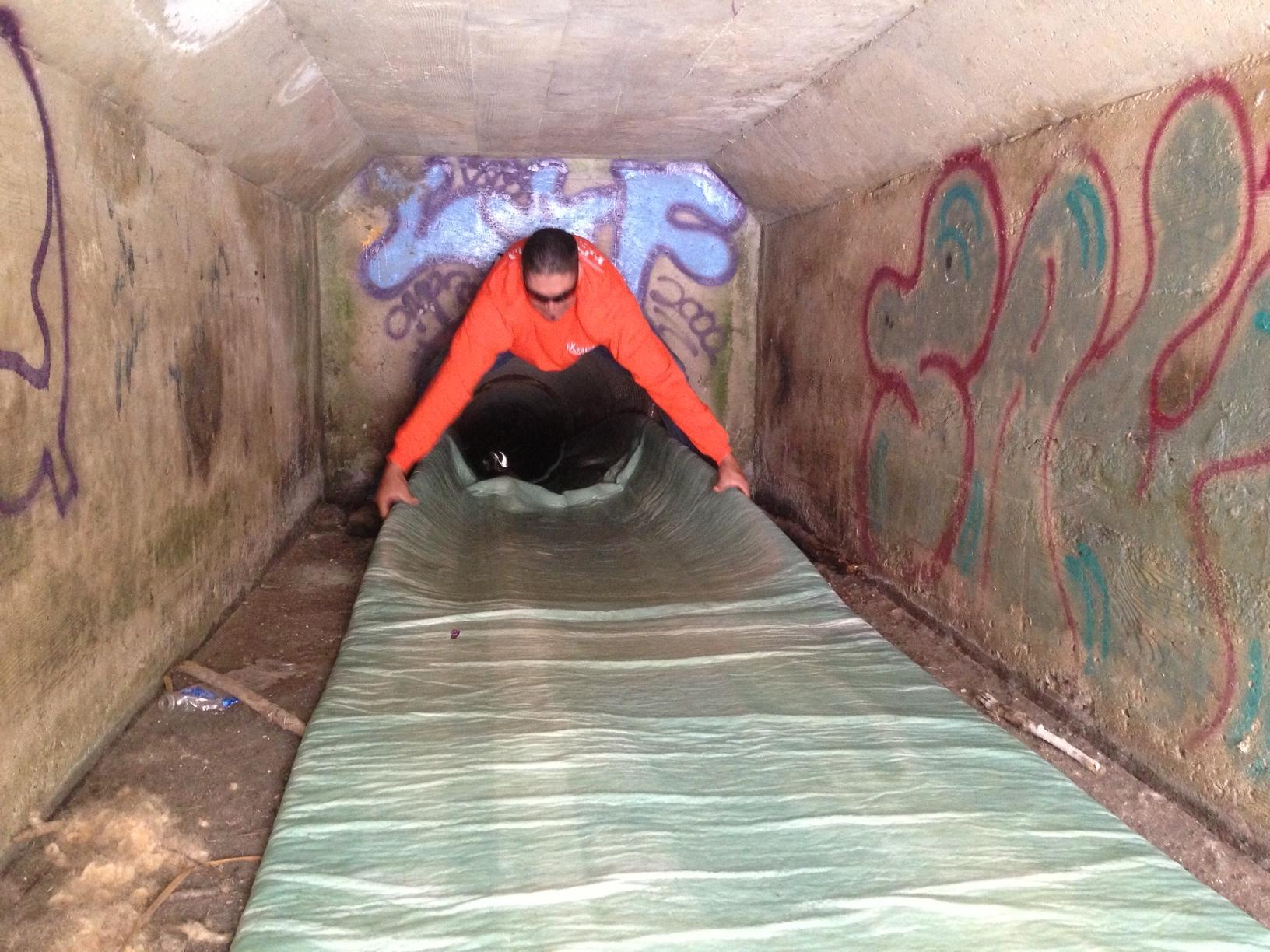Installing manhole-to-manhole lining