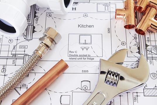 plumbing tools and blueprints